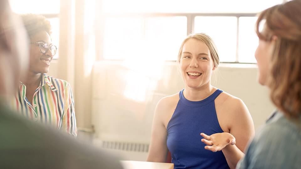 Woman smiling in an informal meeting
