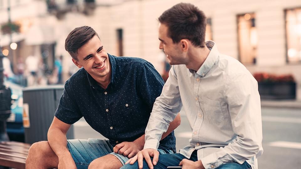 Two men talking in the street