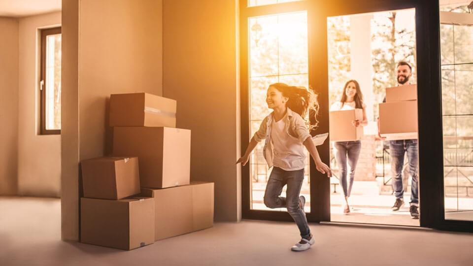 Young family moving into a new house