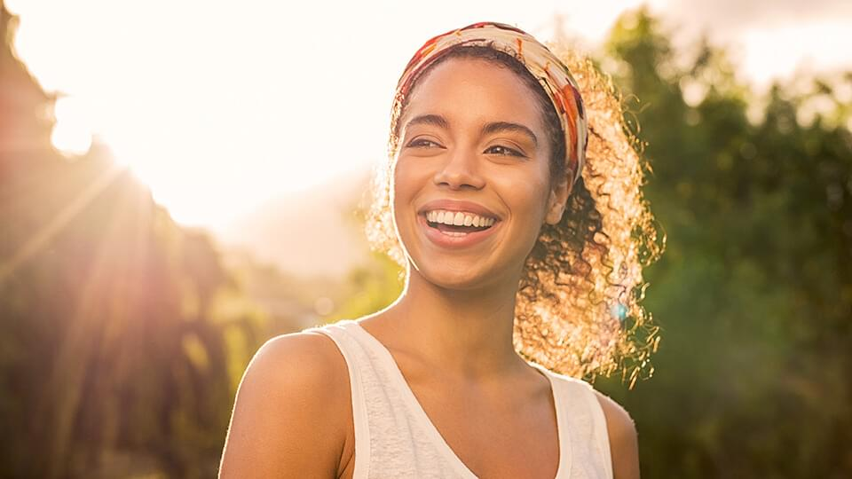 Relaxed woman smiling in garden
