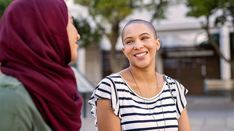 Young woman smiling at friend