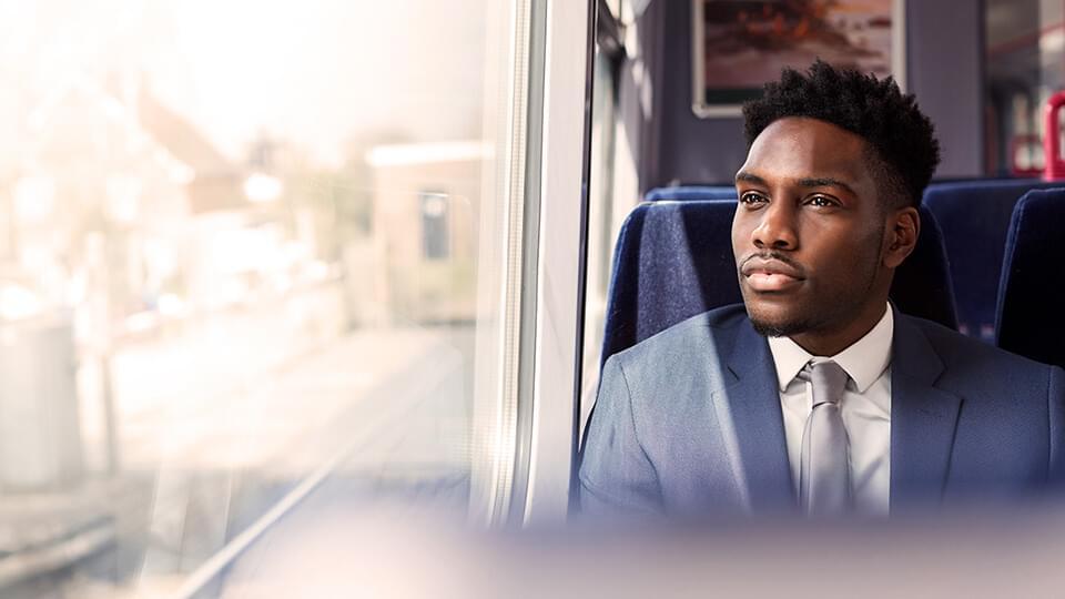 Businessman sitting on a train