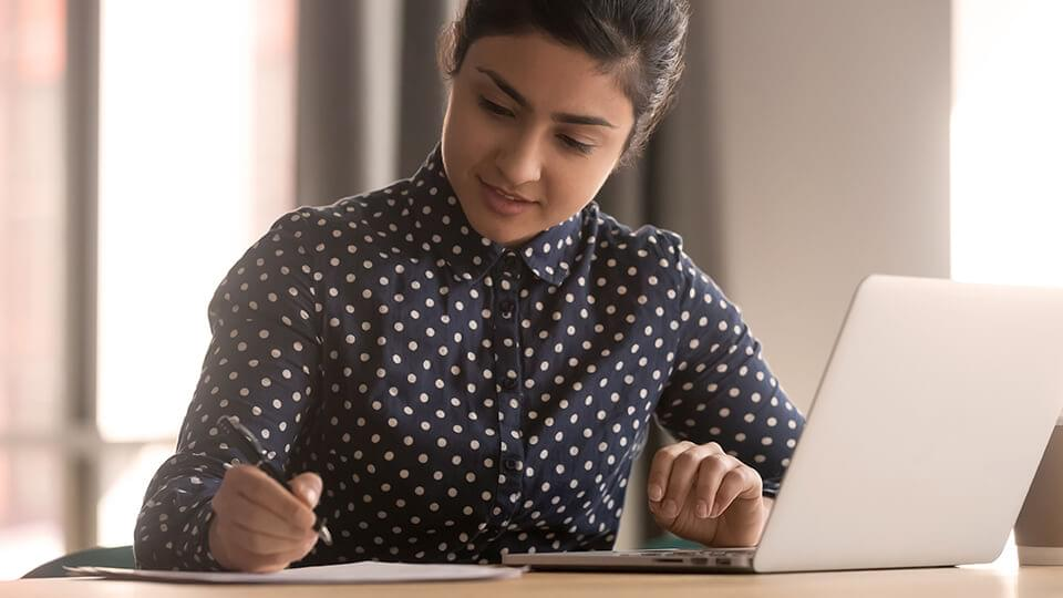 Young woman working at a table