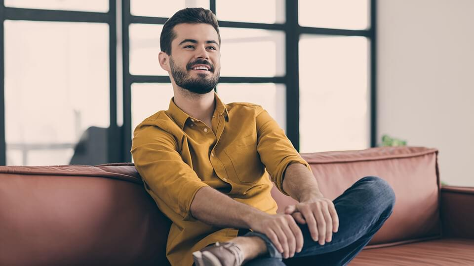 Relaxed man sitting on a sofa