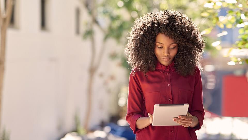 Woman looking down at an Ipad