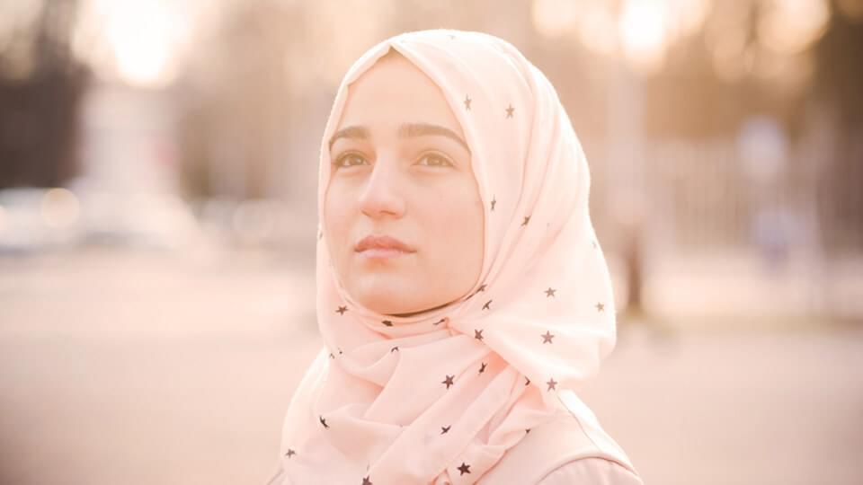 Woman in headscarf outside
